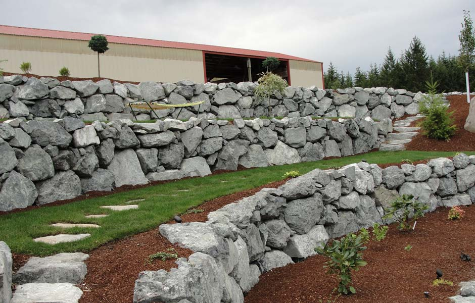 Gallery s a civil earthworkers for Rock wall garden ideas
